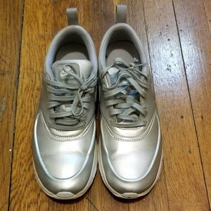 Nike Shoes - Nike silver sneakers size 8